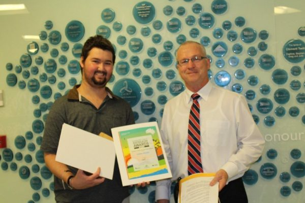 Adem presented with award by Mayor Mark Jamieson at Nambour Hospital